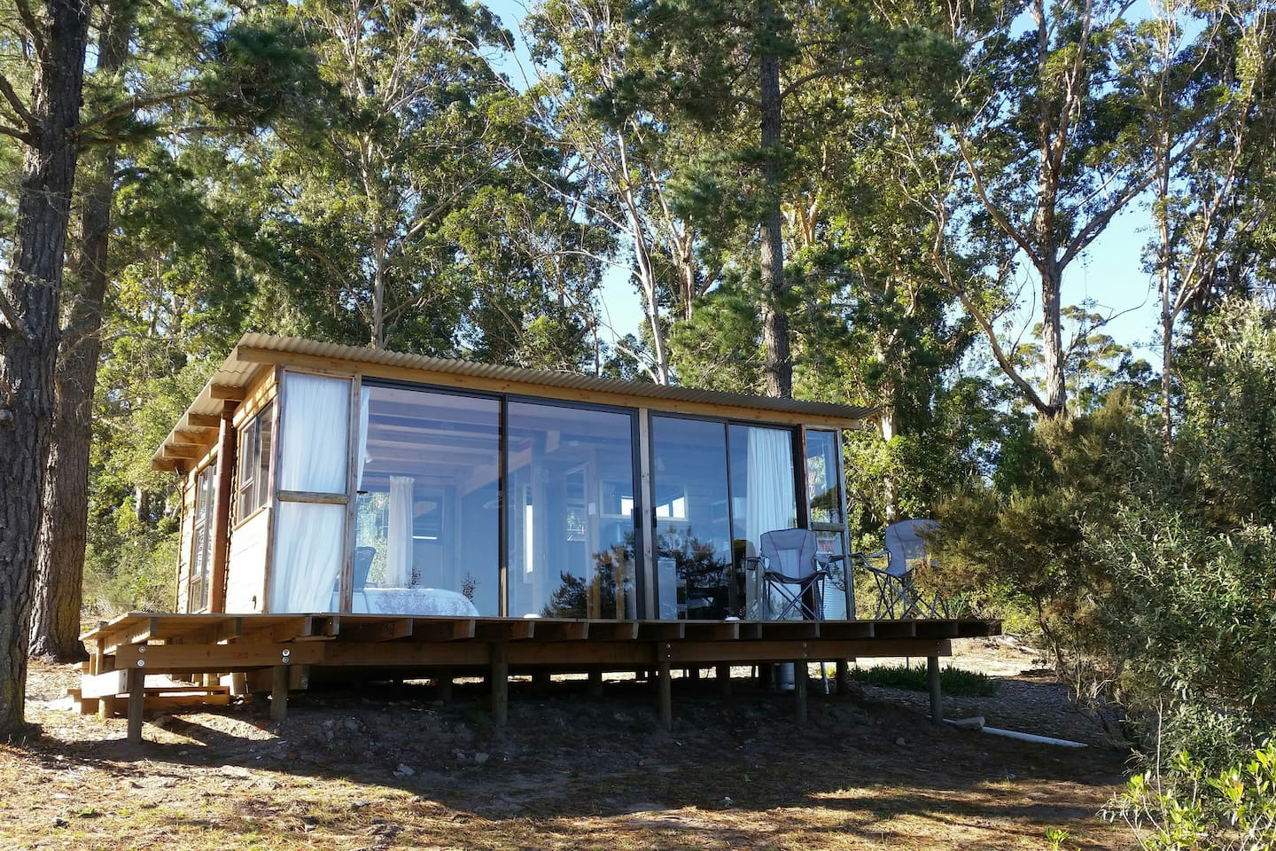 The cabin has a glass frontage to allow you to enjoy the beautiful view of the lake.