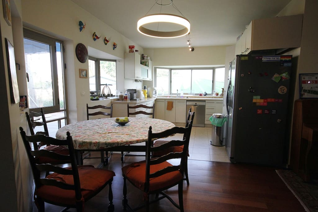 Dining corner, with view on living room, spacious table for 6. Kitchen with dish washer, fridge, washing machine, espresso machine and fresh water machine.