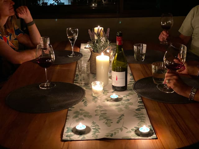 Candle light dinner with friends in the dining room.