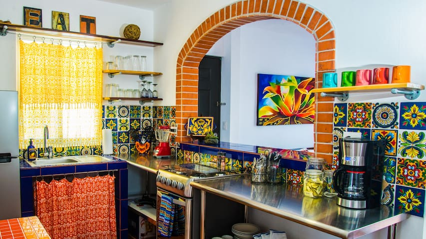 Bright and colourful Mexican kitchen  fully functional with everything you will need during your stay