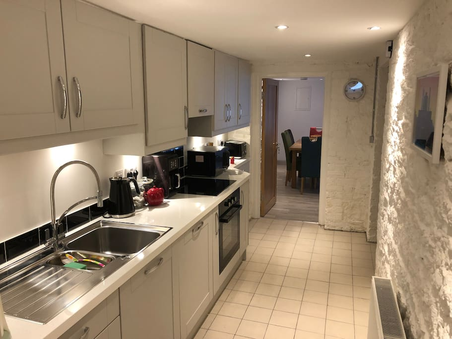 Fully equipped kitchen, with coffee machine, fridge, freezer & dishwasher.