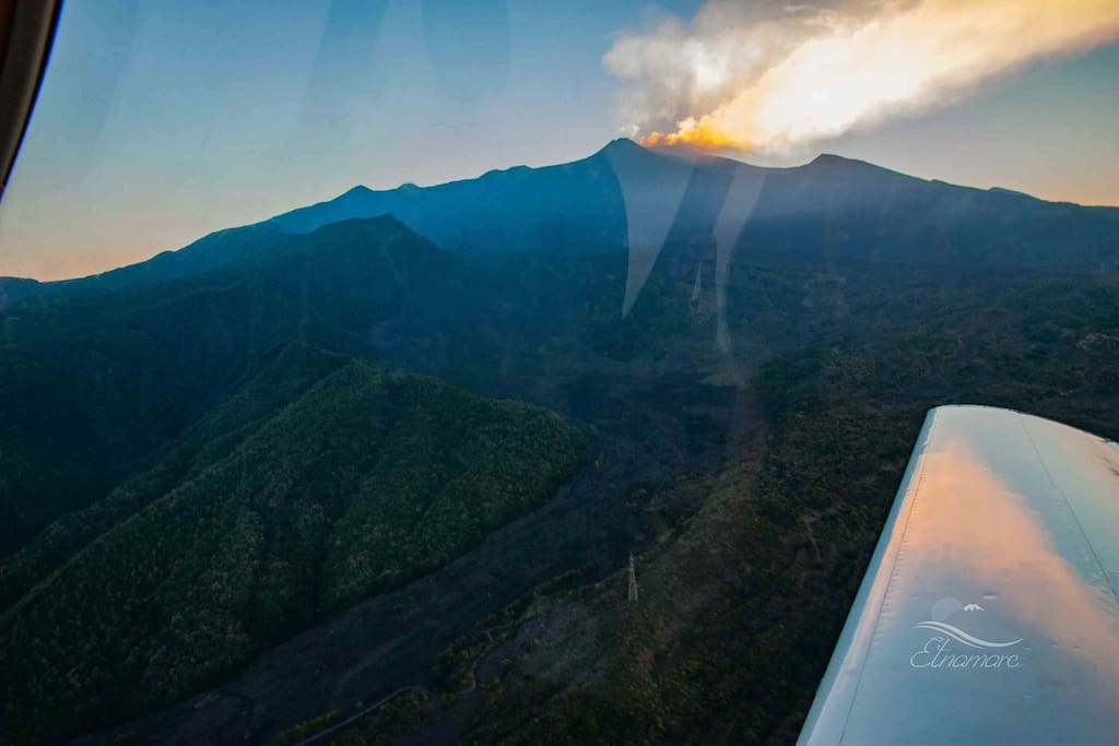 Flying over Valle del Bove where the hot lava flows down during eruptions