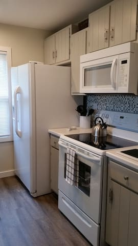 Full size refrigerator and under cabinet microwave.