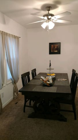 Shared large size dining room that will accommodate any meal setting.