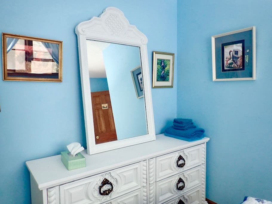 Dresser with mirror, and framed photos of our farm animals on the walls