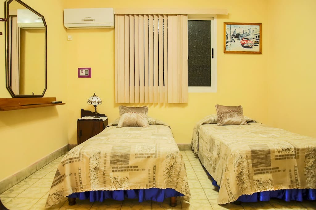 Two twin beds allow for flexibility of sleeping arrangements. Can be joined to create king-size bed.