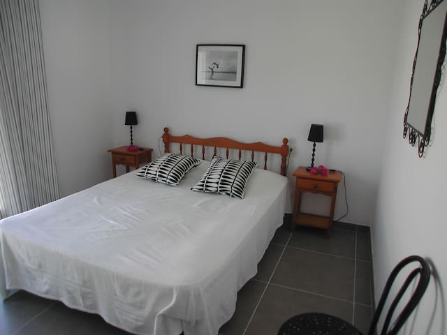 Double bed with doors to the terrace with beautiful view