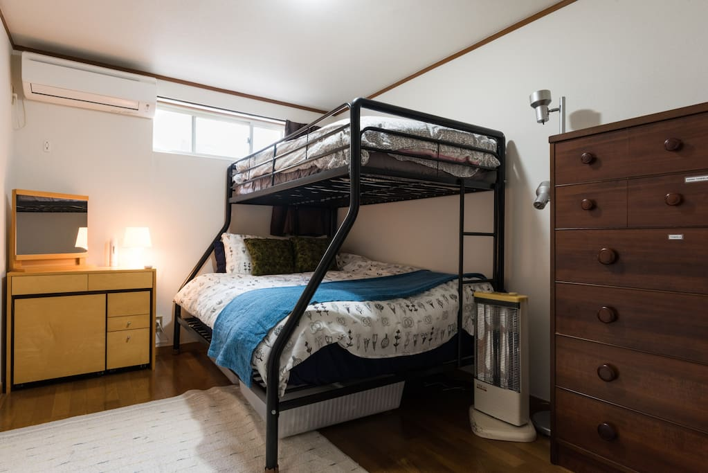 Bedroom - double bed and single top bunk.