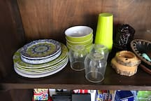 Regular glass plates, bowls and glasses are in kitchen cabinets.  These plastic plates, bowls and cups are in separate wooden hutch in the living area for guests who prefer to use plastic near pool or for younger kids, etc