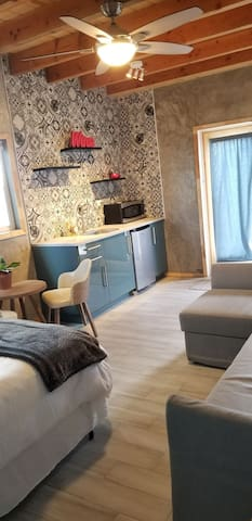Our 3rd bedroom is a studio with a small living area and an adorable kitchenette