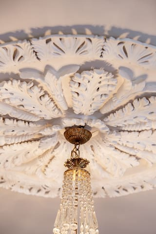 Antique Georgian Rose detail on the ceiling complements the French Chandelier