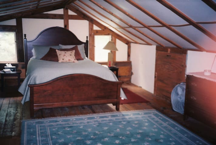 2nd floor - a very comfortable queen bed, 4 sleeping pillows, lots of books & local guide bks. A dresser & 2 wing back chairs are at the other end of the bedroom by the stairs. 2 fans to augment the ac in hot summer weather.