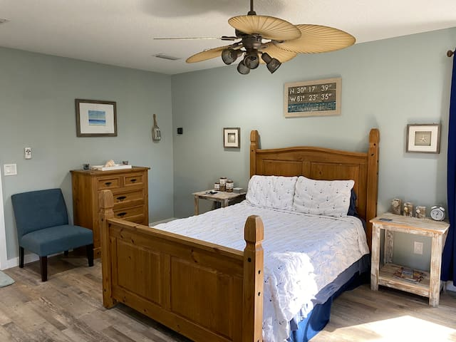 Bed has cozy jersey sheets, Tempur-pedic mattress topper, four plush pillows, and a nautical quilt.