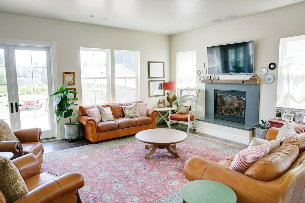 Cozy up in our living room - relax by the fire & visit with friends & family