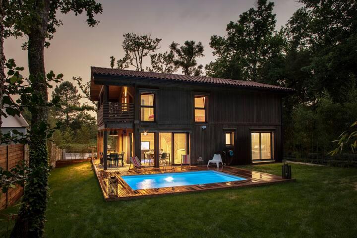 """""""LOU"""" magnifique maison bois avec piscine chauffée"""