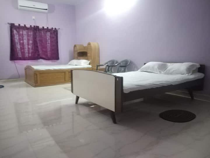 Family AC room for hassle free stay near Rail stn