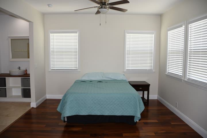 Master Bedroom with Queen Size Bed and Open Bathroom Area