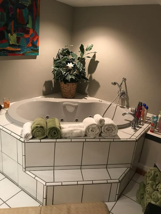 "Relax and unwind in your own private fresh water jacuzzi tub.  This Eight Jet Jacuzzi Tub is sure to please the most tired muscles.  Enjoy, Relax, Unwind, and then feast on some of Regina and Ernesto""s gourmet cuisine and 5-star service just upstairs!! Go ahead...you deserve it!"