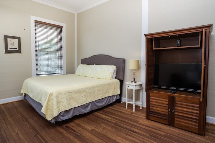 Comfortable king size bed with a wonderful view of downtown Apalachicola.