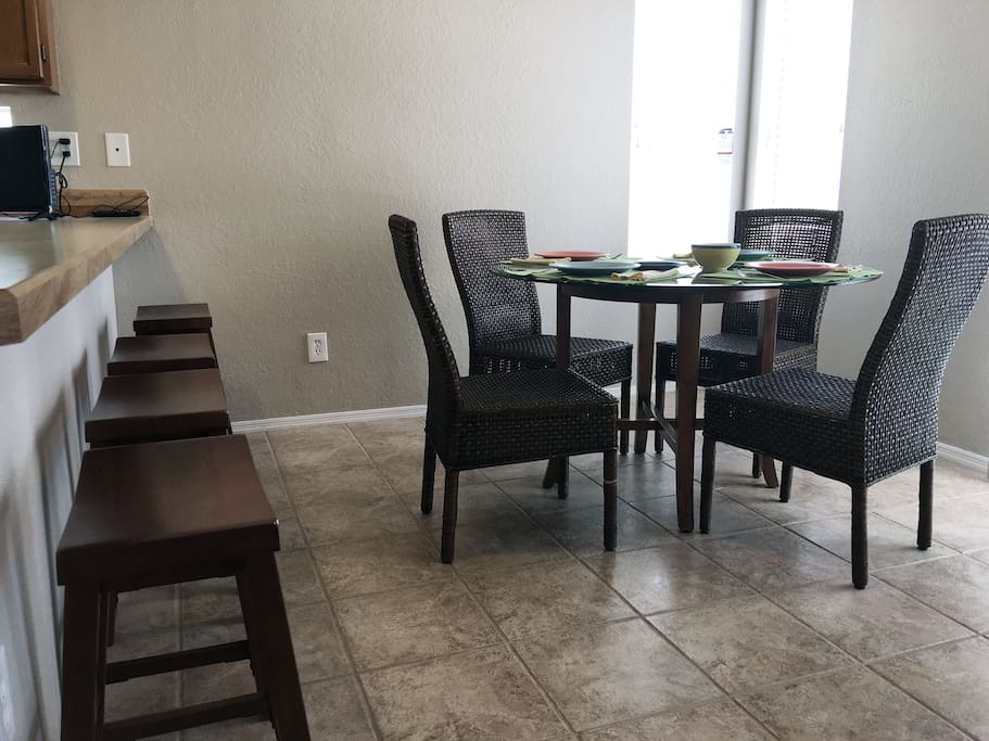 Breakfast bar and dining area is bright and open with sliding door access to patio