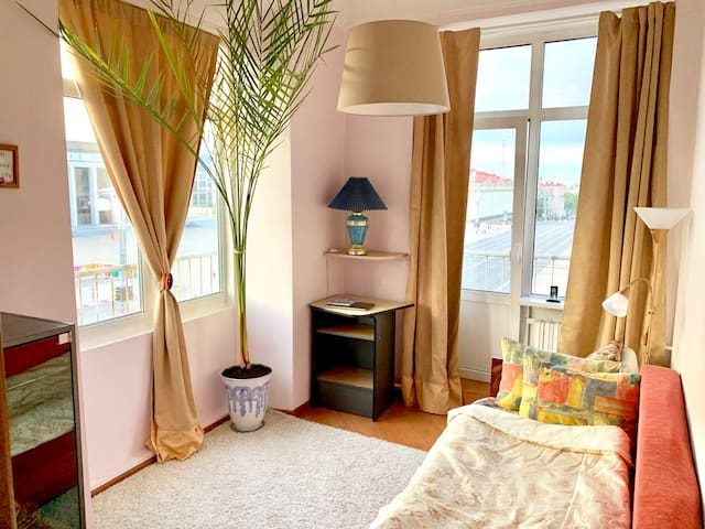 Bright room with a balcony to central square