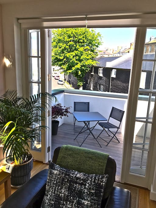 Balcony through French windows, with table & chairs