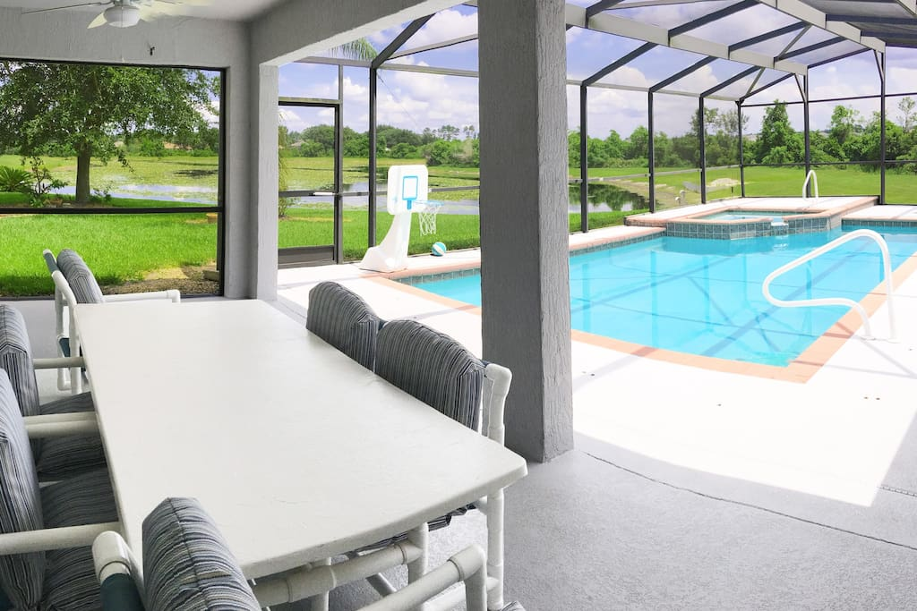 Covered patio with pool and lake view.