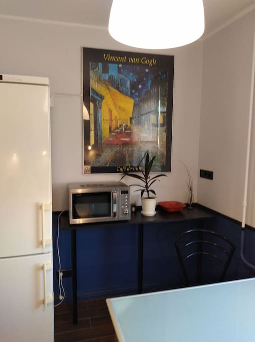 "Fragment of the kitchen with a Van Gogh's reproduction ""Cafe Terrace at Night"". Do you like Vincent? I hope yes))"