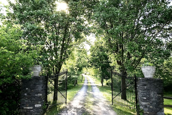 Follow a long winding country road and let the outside world recede behind the gates