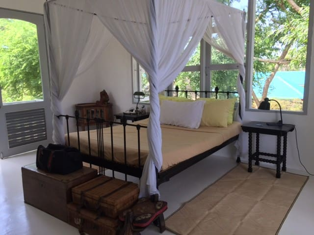 The gentle man's room has an antique double bed with kulambo accompanied by a solid narra aparador