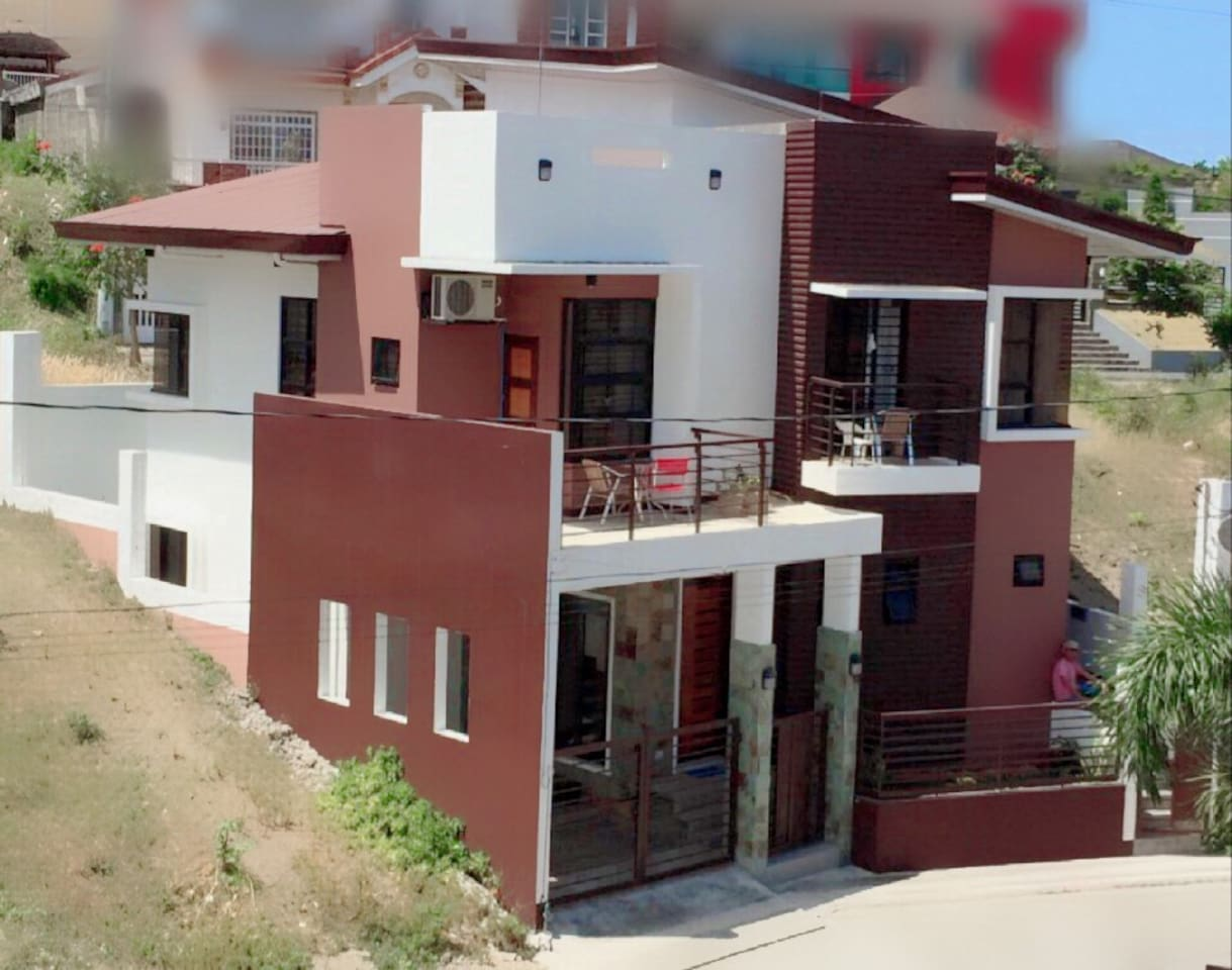 Three sister 3-Unit apartment exterior..  Well designed to look as one big home.