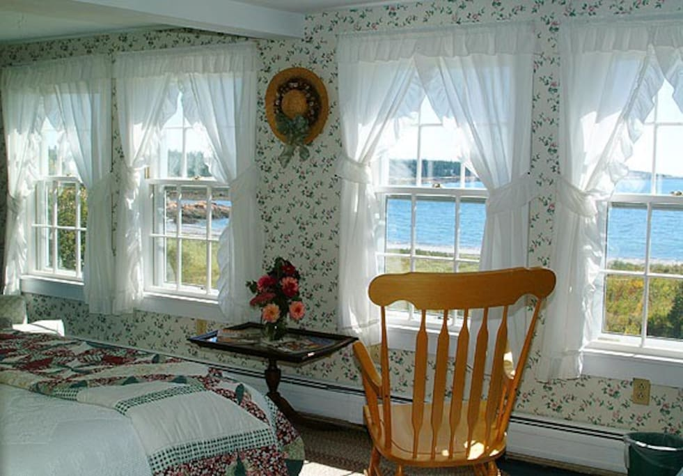 Room S5 in our 1820's  farmhouse of Acadia's Oceanside Meadows Inn offers a magnificent view over the ocean, sandy beach and crashing surf and  has a queen sized bed and private bathroom with a large corner shower.