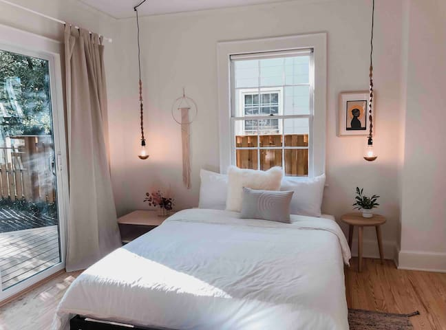 The Master Bedroom comes with a queen bed, closet and large sliding door that leads to the deck/garden.