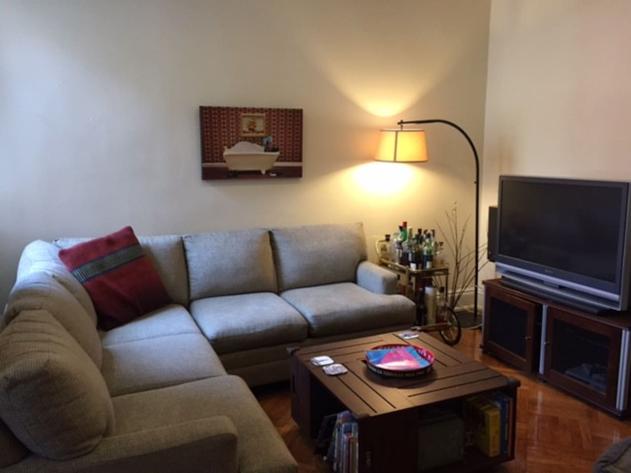 Spacious living room with comfy seating and entertainment options.