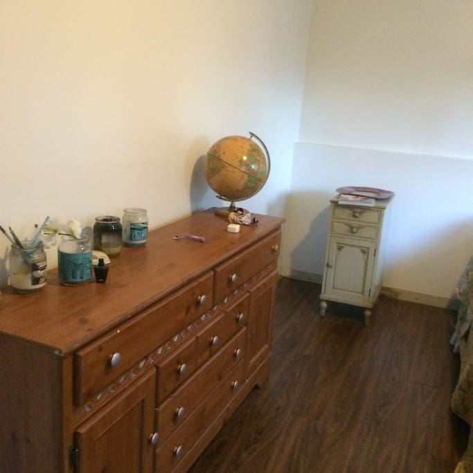 armoire in bedroom; large bedroom.