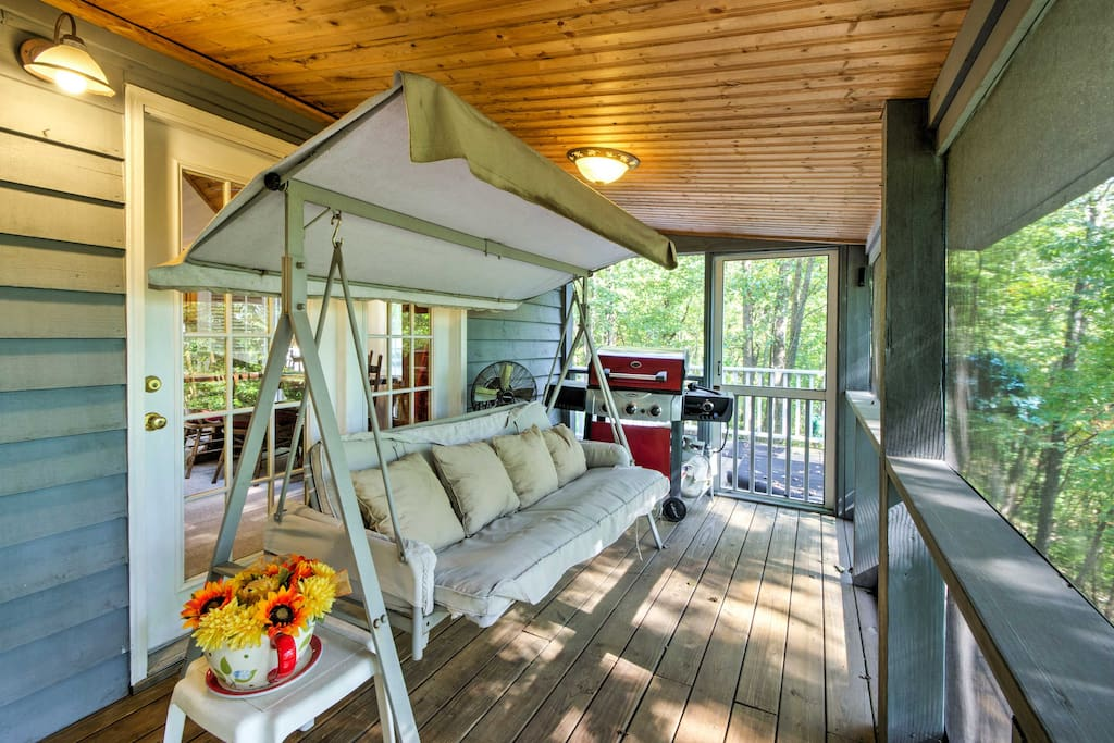 With 2 screened-in porches and a large deck, this home offers many spots to kick back, relax and enjoy the tranquil woodland views.