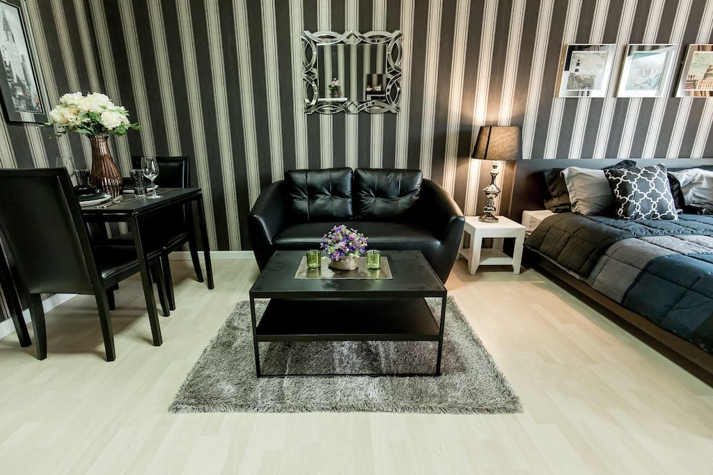 Amazingly designed living area with sofa and dining table for 2.