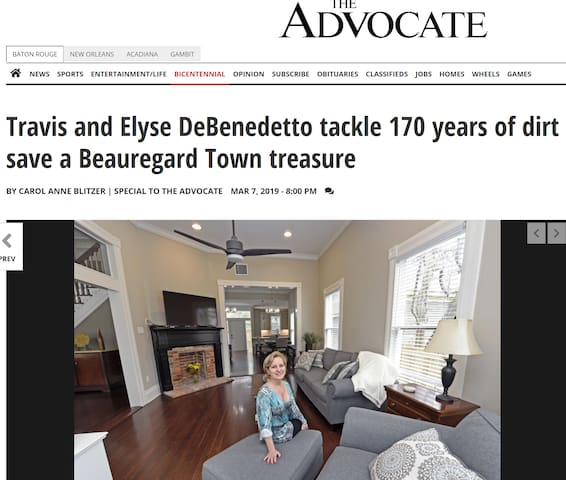 Article in Advocate about restoration of the Rex House with Elyse in photo.