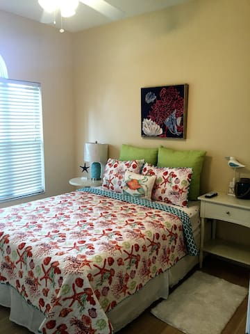 Guest bedroom #2 with queen size bed, large walk in closet
