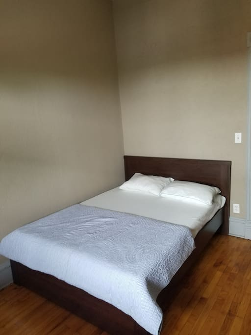 large bedroom with a full-sized bed