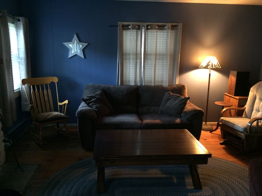 Quaint living room with full sized pull-out sofa bed