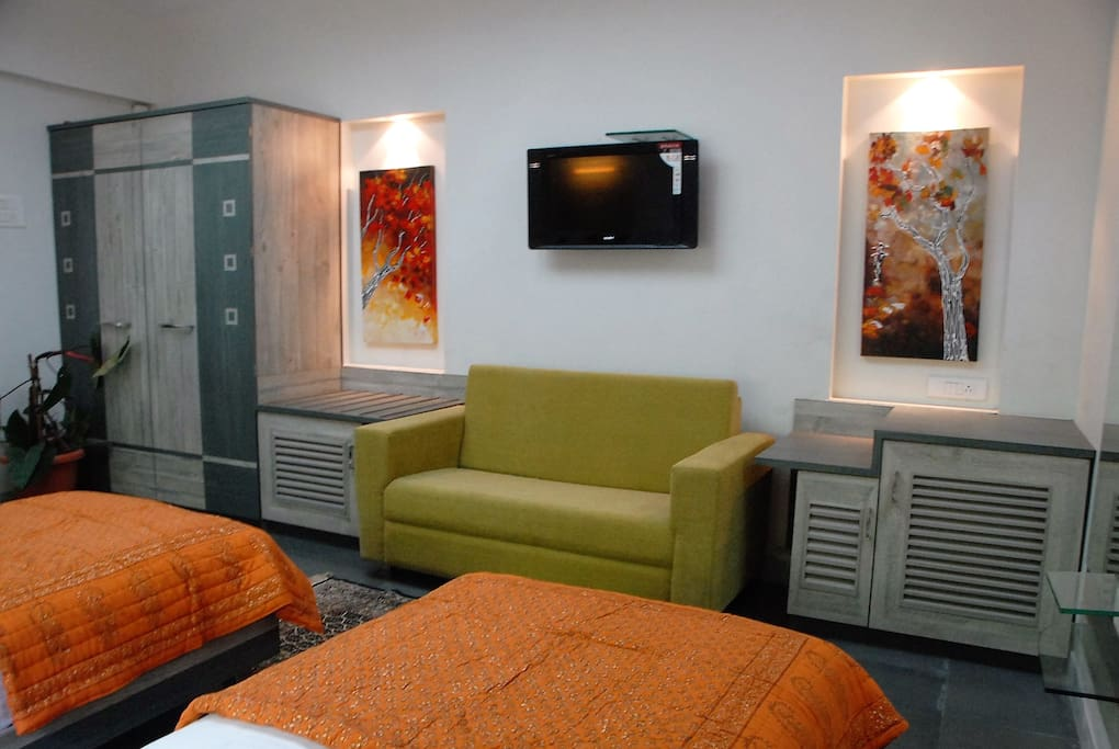 Well appointed room with flatscreen HD TV and cable, double wardrobe, mini refrigerator, electronic safe, split air conditioning, work table, etc