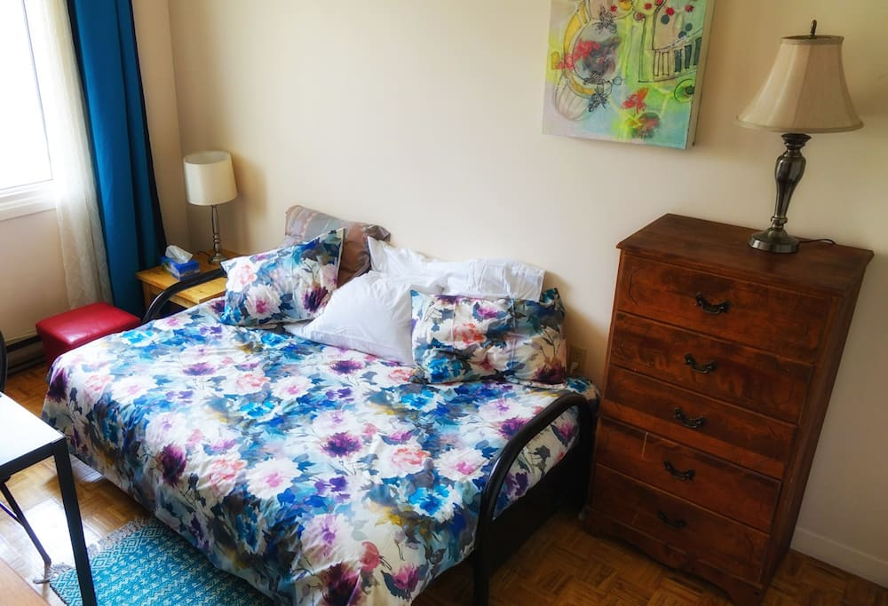 The mattress is a top-of-the-line futon with foam and cotton. It's quite firm and comfortable. The bed can be converted into a couch, though no-one has done this yet.