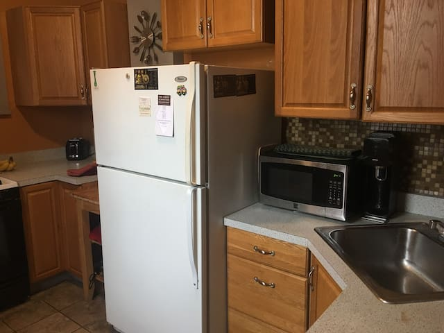Kitchen with microwave and dishwasher.