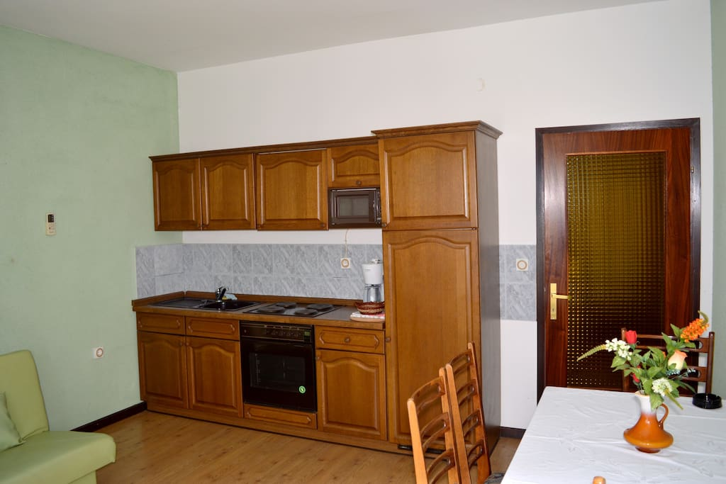 The kitchen and the dinning table