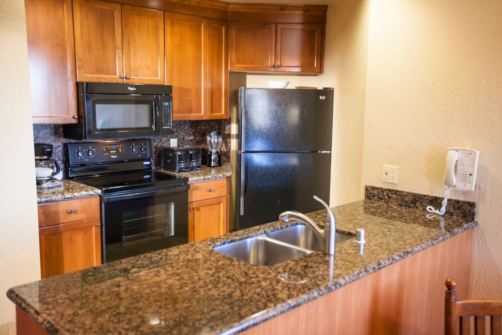 Granite counters in the kitchen. Cooking necessities supplied
