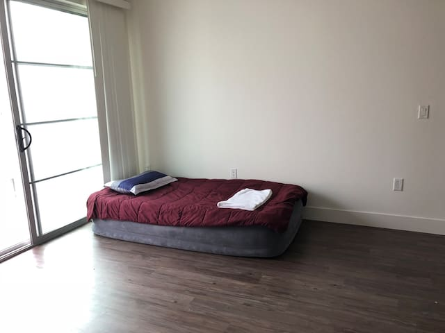 Large living room space with an air bed in NoHo