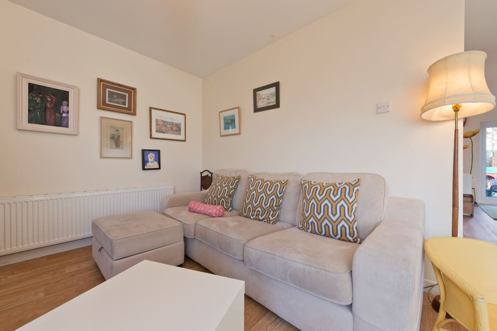 Large comfortable counch for relaxing after a hard day of sight-seeing. Faces onto large flat screen TV.
