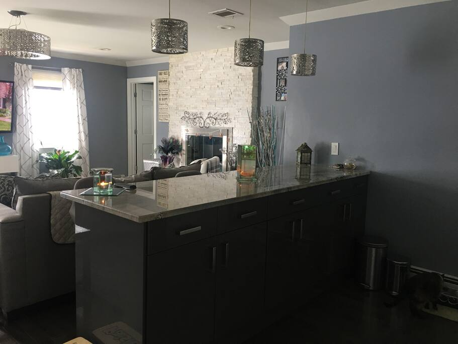 Kitchen island area with 3 stools to sit for a quick bite