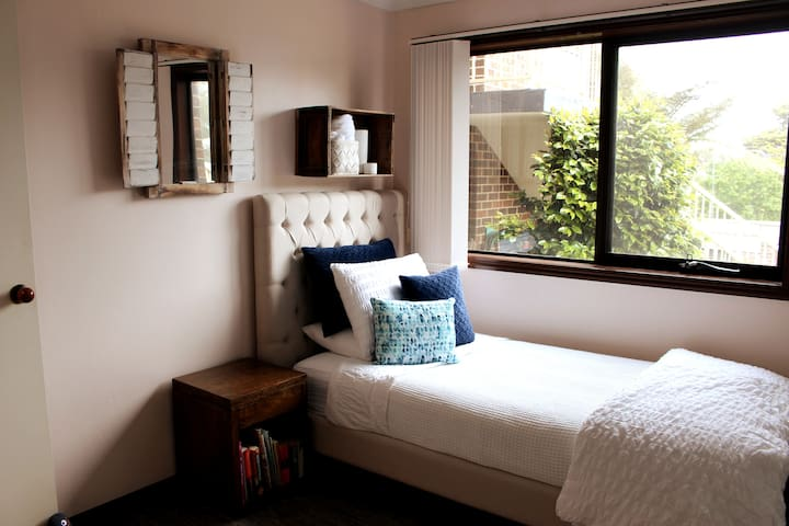 2nd bedroom with comfortable king-single and built-in robe.